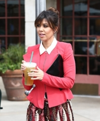 Kourtney-Kardashian-Peplum-Jacket-Patterned-Shorts-9-387x470